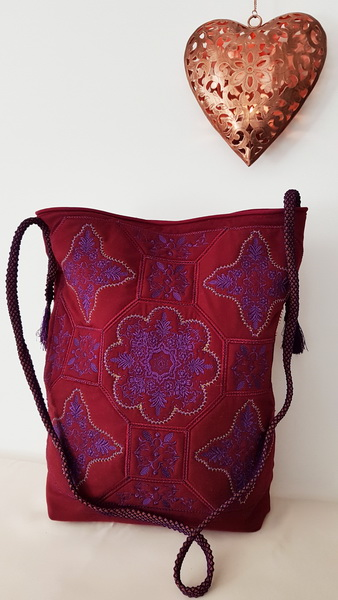 Panache Machine Embroidery Designs by Stitchingart. Red bag. Floral decorative artistic designs.