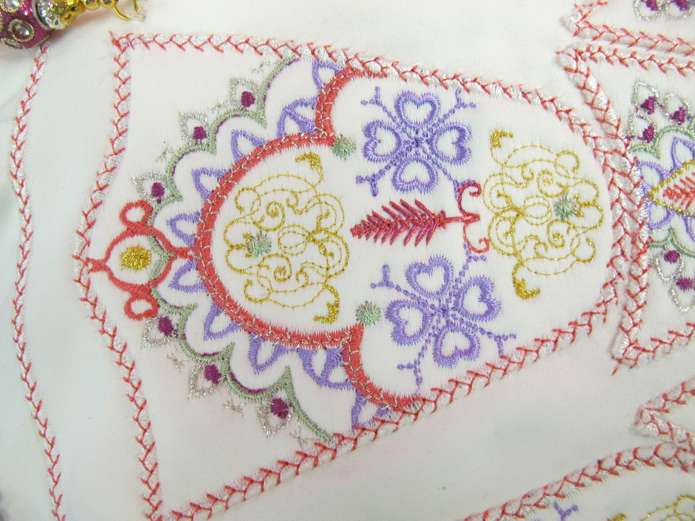 Scene Stealing Machine Embroidery Designs by Stitchingart. Artistic decorative pattern poof and foot stool.