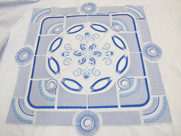 Blue Crush Machine Embroidery Designs by Stitchingart. Artistic decorative blue and white cushion.