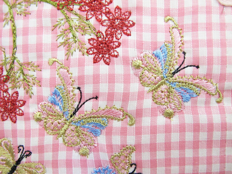 Earth Dance Machine Embroidery Designs. Butterfly, love hears, floral and flower gingham wall hanging. Pretty machine embroidery design.