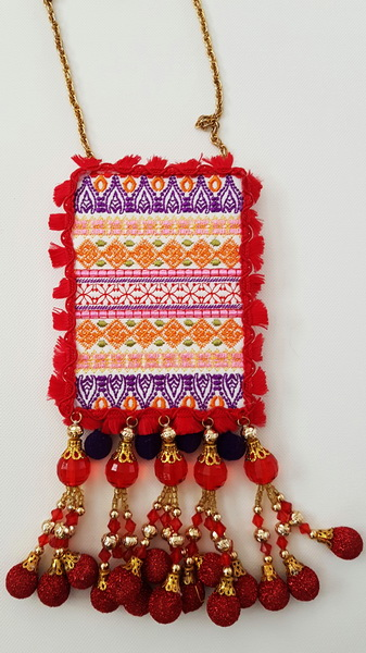 Grand Entrance Machine Embroidery Designs. Close up of artistic red pattern embroidered necklace.