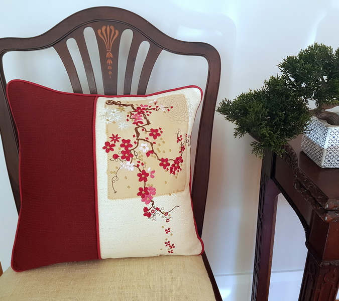 In the Air Machine Embroidery Designs by Stitchingart. Embroidered floral cushion.