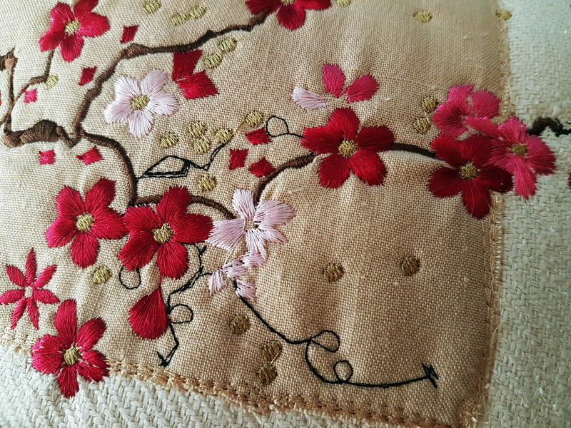 In the Air Machine Embroidery Designs. Close up of embroiderd floral cushion.