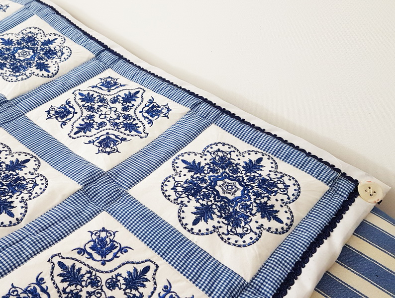 Panache Machine Embroidery Designs by Stitchingart. Patchwork floral blue and white quilt.