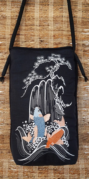 Spring of Life Machine Embroidery Design Bag. Black bag with Koi, waterfall and blossom tree