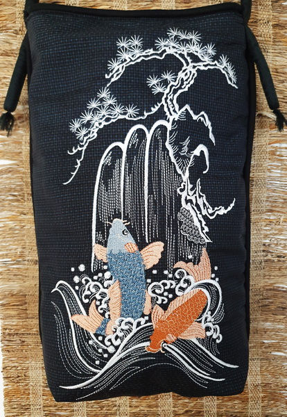Spring of Life Machine Embroidery Design Bag. Black bag with Koi, waterfall and blossom tree. Close up