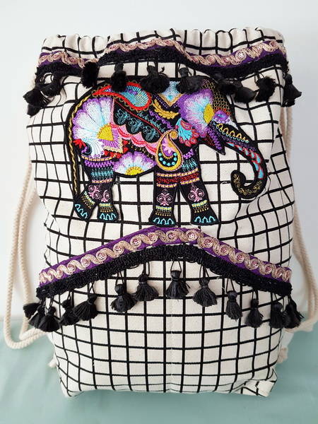 Wild and Free Machine Embroidery Designs by Stitchingart. Embroidered artistic colourful elephant cushion.